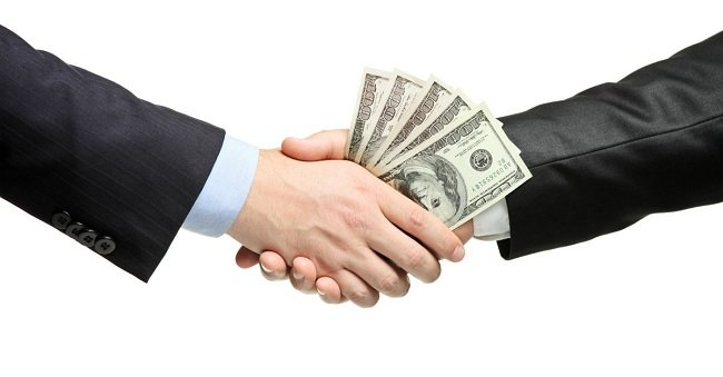 25364-lending-borrowing-money-shake-hands-debt-dollars-business-deal-wide-1200w-tn_